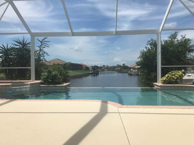 Photo for AMAZING VIEW - Stunning canal view, southern exposure, gulf access pool home.