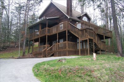 These two wrap around decks were built for mountain views and entertainment!