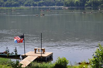 A view of our boat dock and kayakers enjoying the river.  Taken from our deck.