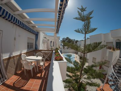 Photo for Apartment 80m2 large terrace, pool, 100m beach