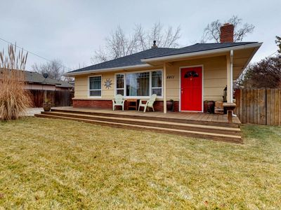 Photo for Cute dog-friendly bungalow with private hot tub, outdoor firepit, patio, & more!
