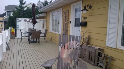 Spacious 35 foot front deck with patio table and chairs.