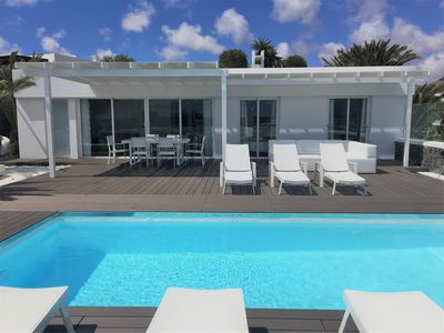 Photo for Stylish and modern villa with private heated pool