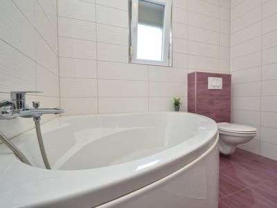 Photo for Vacation home Stipe in Novigrad (Zadar) - 6 persons, 3 bedrooms