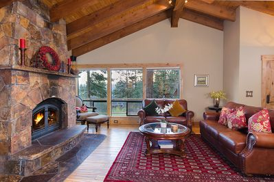 Great Room with Custom Stone Fireplace, Cathedral Ceilings & Luxury Furnishings