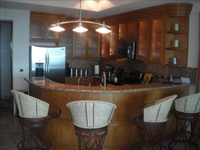 Kitchen with granite countertops, SS appliances, and well stocked for cooking