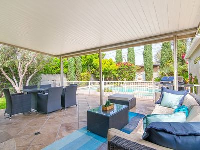 Covered Seating Area with view to pool and barbecue. Great for al fresco dining.