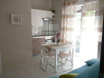 Photo for Marina di Porto Maurizio: Bright new apartment with nice terrace in Liguria