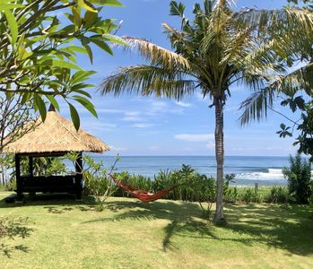 Photo for 5 * Seafront villa 'Bagus', private cook, private pool & big garden, coral reef