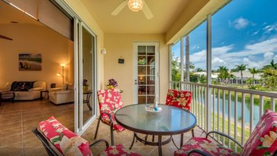Photo for Gated Cape Harbour Boating Community Waterfront Condo with Sunset View.