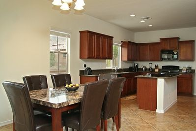 Dining & Kitchen Areas with Diagonal Floor Tiles