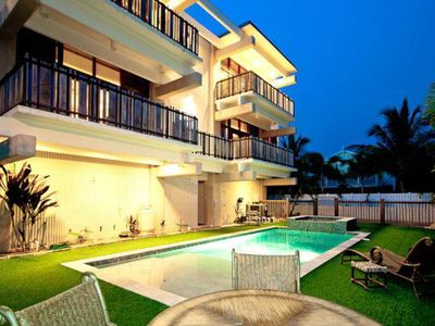 Photo for Modern home with pool and balconies - steps to Bean Point Beach, dogs OK!