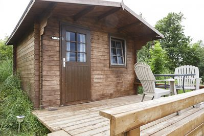 The Front Deck of the Bunkie features two patio chairs and a table.