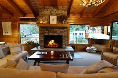 Lounge with open stone fire and 65andquot;TV with SKY