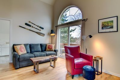 Newly remodeled - solid maple tables, hotel sleeper sofa and cozy red chair