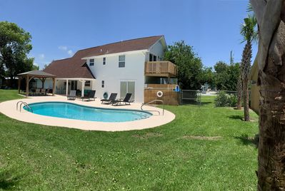 Enjoy a great outdoor space, a beautiful pool deck and a bbq shack!