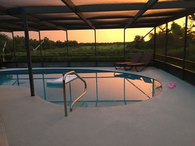 Photo for Gorgeous, private, canal, pool home