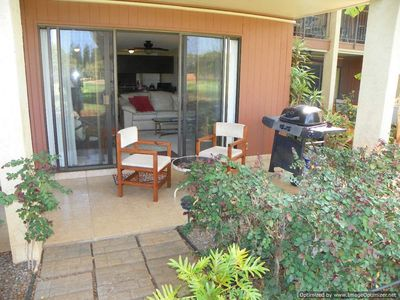 LANAI WITH GAS GRILL LOOKING IN TO LIVING ROOM