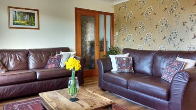bright, spacious living / dining area with views down Glen Shellach