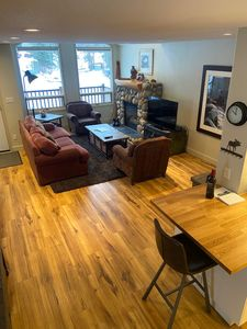 Spacious main living room with hardwood, comfy couch&chairs, fireplace & LED TV.