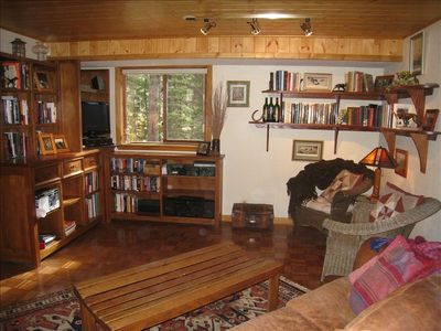 TV Room on Main Level - large leather sleeper sofa, comfy chairs, satellite TV