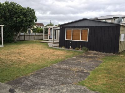 Photo for Central Whanga Beach Bach - Walk to Beach and Town. Open Plan Living