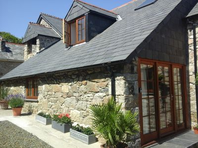 Photo for Luxury Barn Conversion in Tranquil Village. Ideal Location for both Coasts.