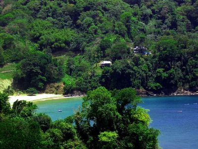 Photo for COASTING - 5 acres of waterfront; romantic villa, with pool; beside beach.