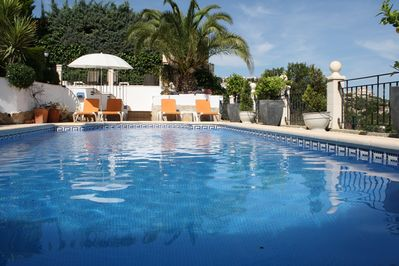 Pool with plenty of terraces and loungers
