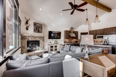 Comfortable seating for the fireplace and TV.