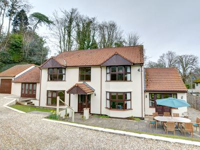 Photo for Set in beautiful grounds and only a few minutes walk from the beach, this four-bedroomed luxury hous