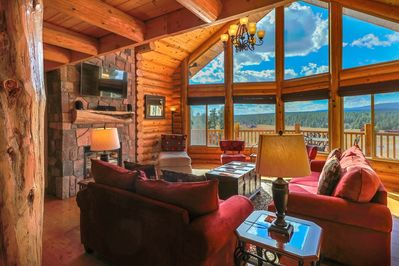 Spacious great room has  fireplace and smart HDTV & panoramic views of mountains