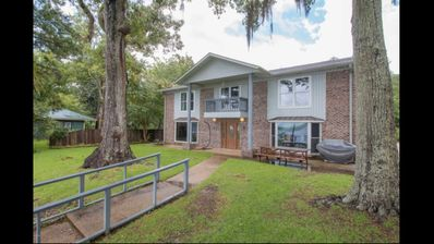Photo for Beautiful home with swimming pool and boat dock on the Pascagoula River