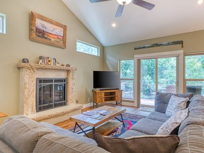 Photo for Modern riverfront home w/ a private hot tub & gas fireplace in a quiet community