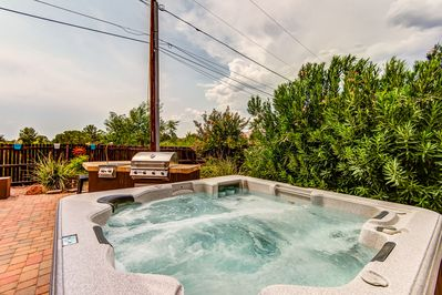 Expansive Back Patio with a Private 6-Seat Hot Tub, BBQ, Fireplace, Sofa and TV
