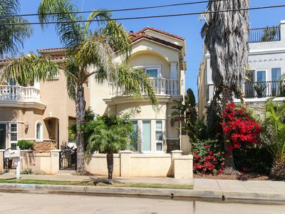 Photo for Updated home w/ balconies and rooftop deck - 2 blocks to the beach!