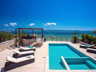 Photo for Beachfront Villa Draga with 32sqm private, heated pool, 4 bedrooms, sea view