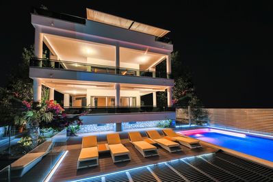 House exterior with pool & sun deck