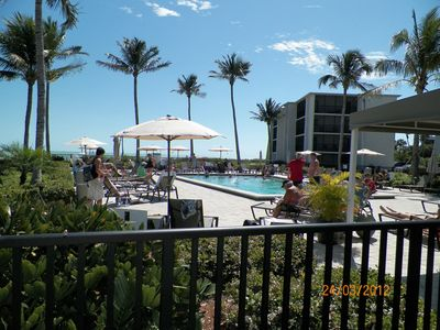 K303 Heated Beachfront pool w/large sundeck, chairs, umbrellas free for your use