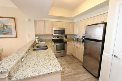 Fully equipped kitchen with stainless steel appliances and granite counter tops
