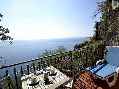 Photo for 2 bedroom Villa, sleeps 4 with Air Con and Walk to Beach & Shops