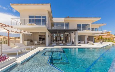 Photo for UNBEATABLE Luxury Villa w/ HUGE Private Pool, 2 Golf Carts, Putting Green & MORE