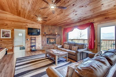 Boasts a huge great room, with a wall of windows looking at the mountains