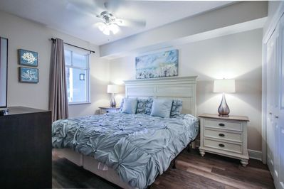2nd bedroom with king bed and attached bath