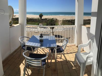 Photo for Beach front holiday apartment with terrace and unspoilt sea view, sleeps 4.
