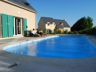 Photo for Luxurious new house on Omaha Beach golf course, private heated pool