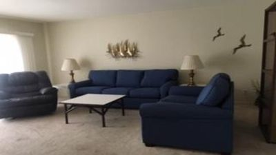 gorgeous new  queen sleeper sofa and love seat in living room