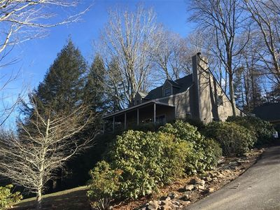 Photo for SPOON FULL OF SUGAR IS A WINTER WONDERLAND cabin near skiing, tubing, hiking, shopping and area restaurants. Spacious Greatroom with stone fireplace, wrap around covered porch, two car garage and mountain view. Minutes to Skiing at Sugar Mountain or Beech Mountain,15 mins to Tubing at Hawksnest, 25 mins to Downtown Boone.