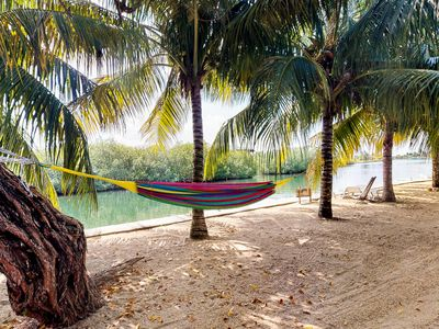 Photo for Lakefront house with enclosed yard, hammock & outstanding location