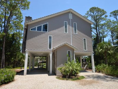 Photo for BEAUTIFUL LANDSCAPING AND NATURAL vegetation surround this comfortable bay front home.